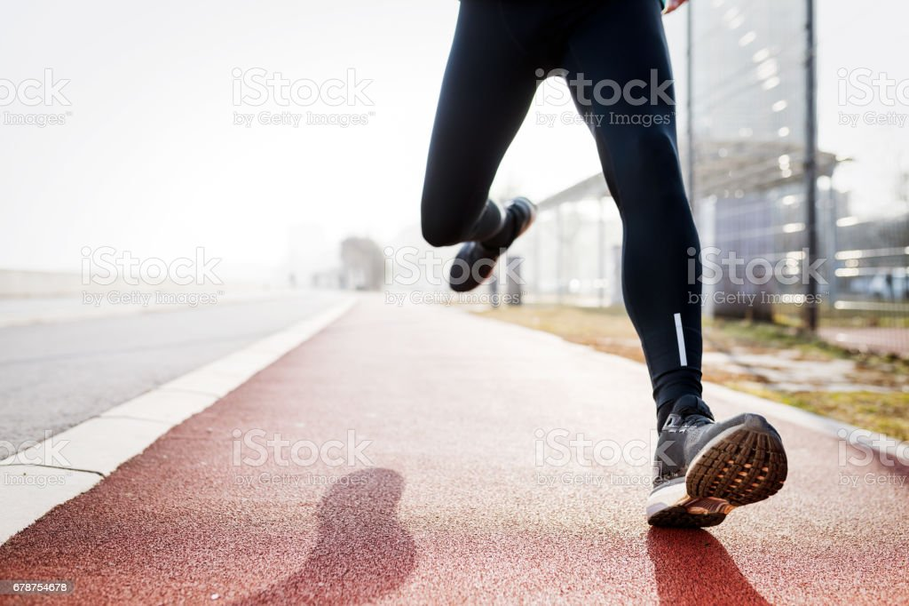 Healthy determined sportsman fitness exercising by jogging outdoor photo libre de droits