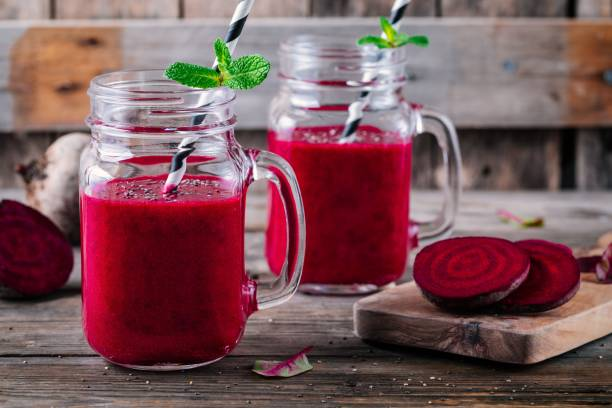 healthy detox beet smoothie with chia seeds in a mason jar on a wooden background healthy detox beet smoothie with chia seeds in a mason jar on a wooden background beet stock pictures, royalty-free photos & images