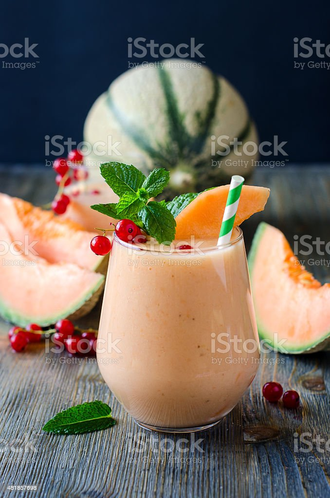 Healthy detox vitamin smoothie drink with melon stock photo