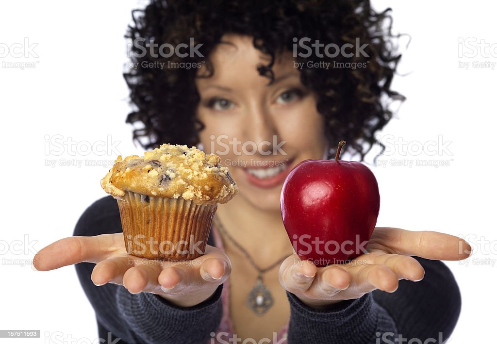 ' Healthy Diet Choices' Woman Hands Holding Muffin VS Apple stock photo