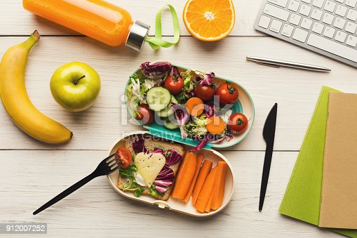 istock Healthy dinner from lunch box at office working table 912007252
