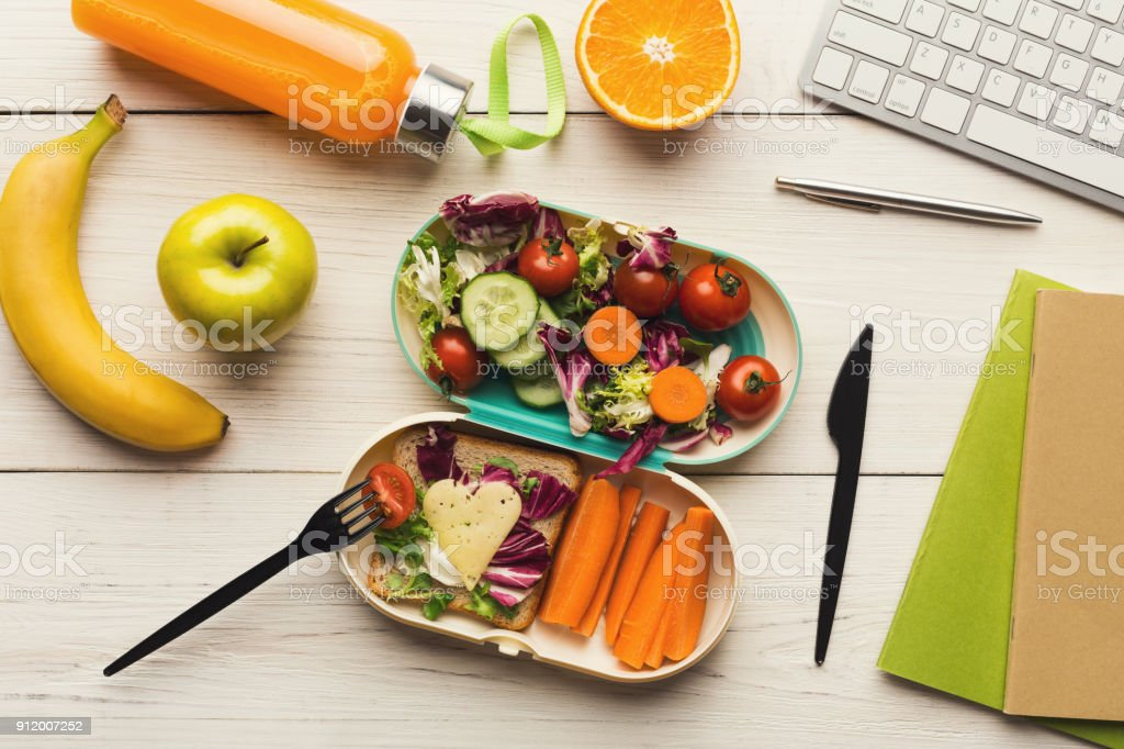 Healthy dinner from lunch box at office working table stock photo
