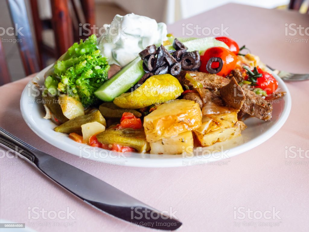 Healthy Dinner Plate Full Of Stewed Vegetables And Rice With Natural