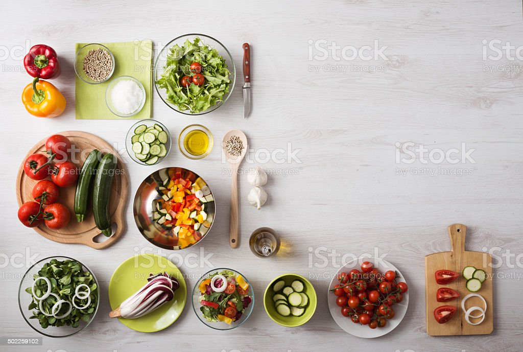 Healthy eating concept with fresh vegetables and salad bowls on...