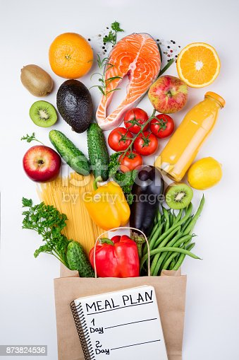 istock Healthy eating background. Healthy food in full paper bag of fish, vegetables and fruits on white. Meal planning concept 873824536