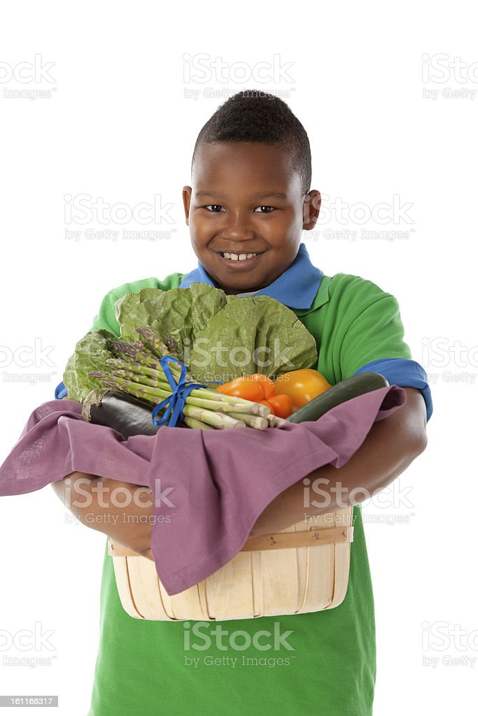 Healthy Eating: Black Little Boy Holding Basket Vegetables Waist Up royalty-free stock photo
