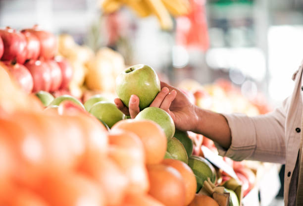 Healthy eating concept. Buying fruits, close-up. stock photo