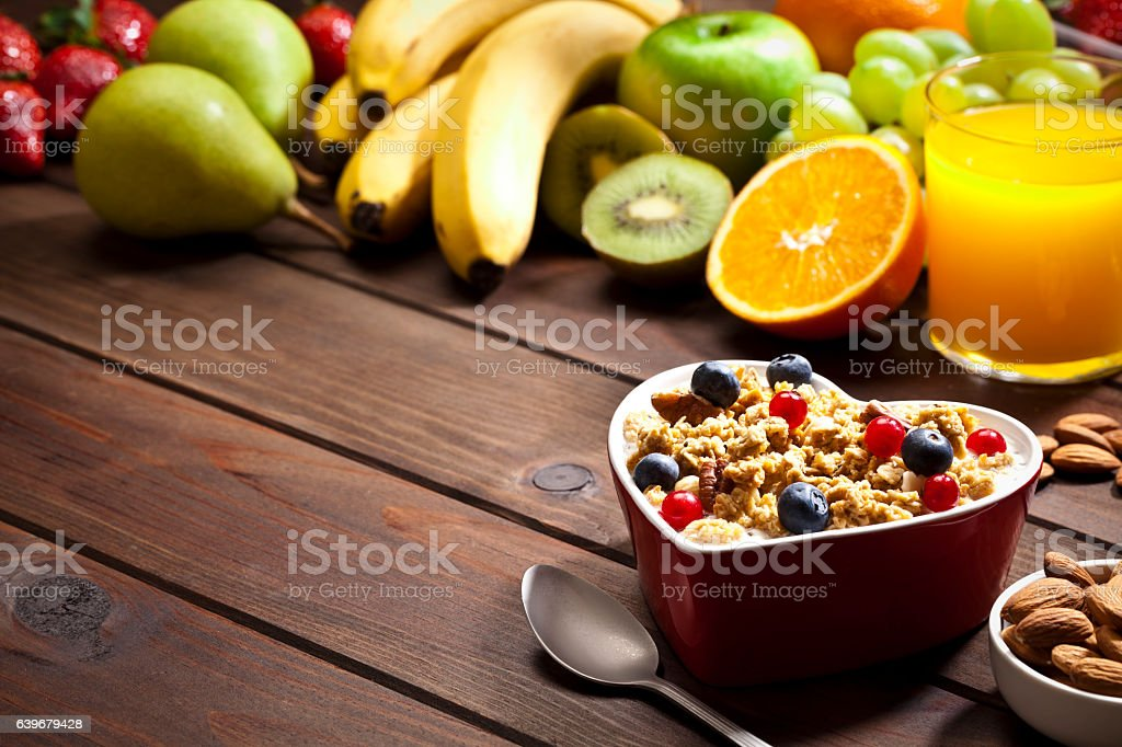 Healthy eating concept: heart shaped bowl with yogurt and cereal stock photo