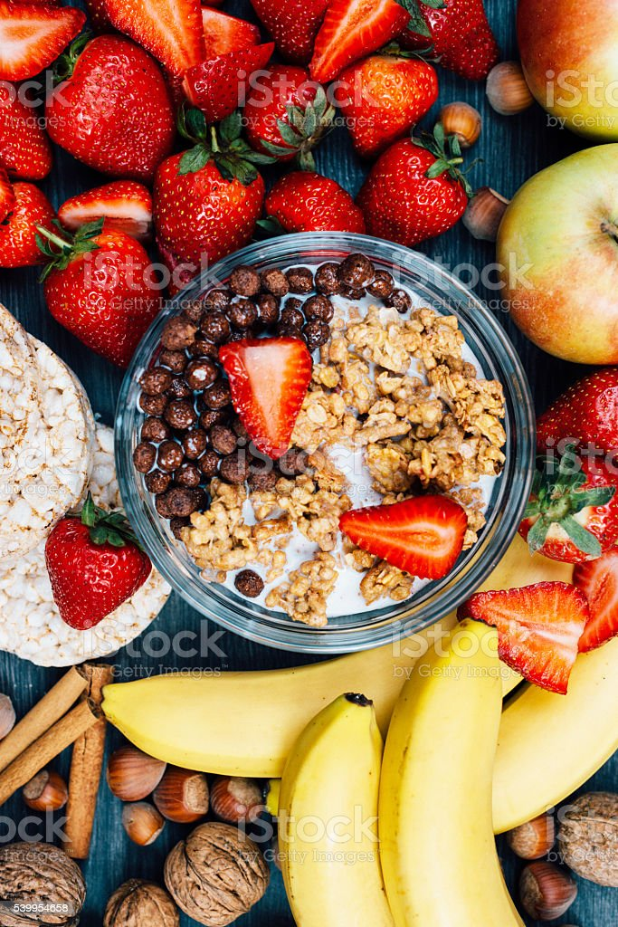 Healthy eating concept - strawberries, bananas and cereals stock photo
