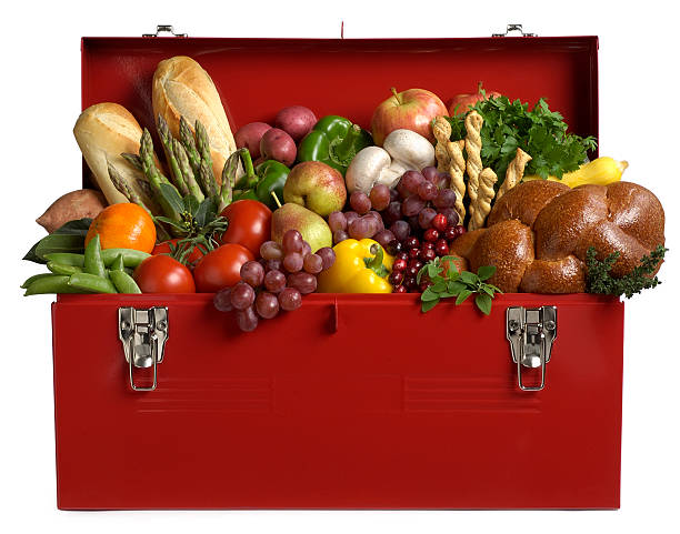 Healthy Eating, Cornucopia of Fruits and Vegetables in a Toolbox stock photo
