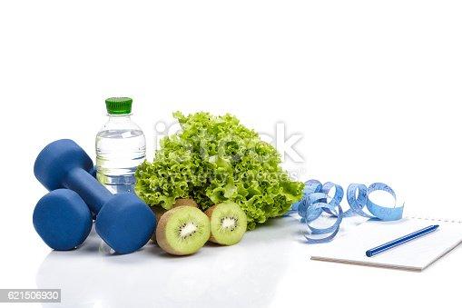 istock healthy eating, diet and  detox . dumbbells, kiwi  water 621506930