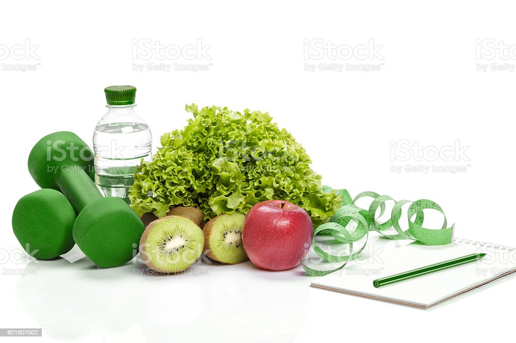 healthy eating, diet and  detox . dumbbells, kiwi  water