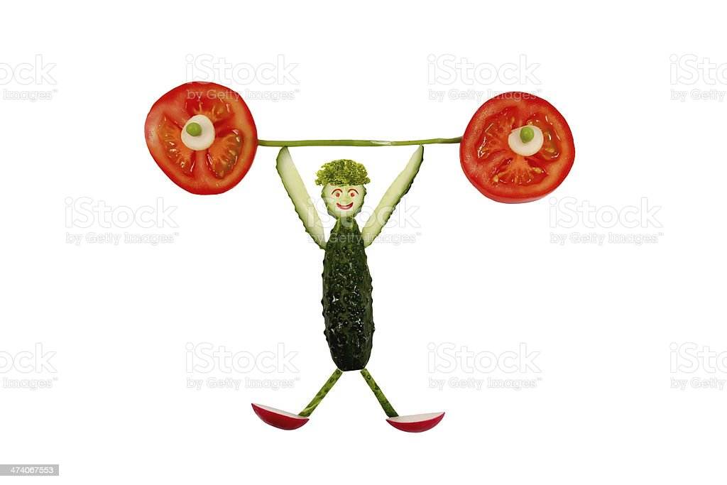 Healthy eating. Funny little man of the cucumber slices royalty-free stock photo