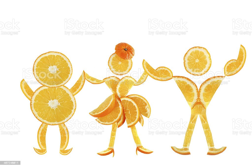 Healthy eating. Funny little people made of the orange stock photo