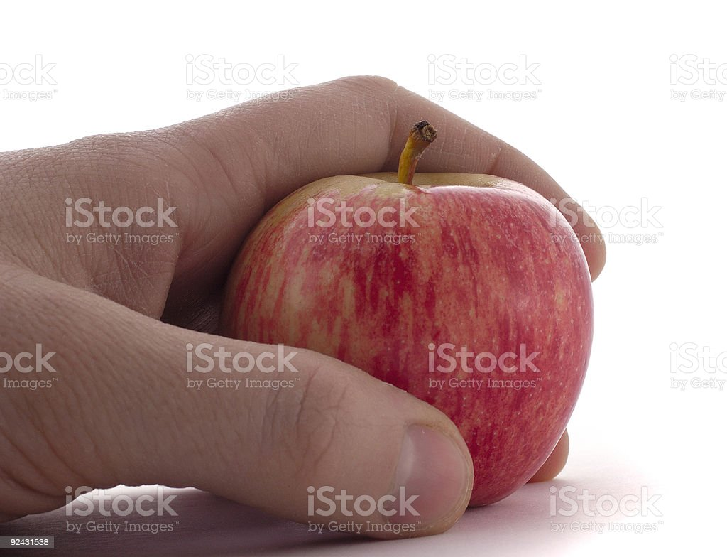 healthy eating: male hand holding an apple isolated royalty-free stock photo