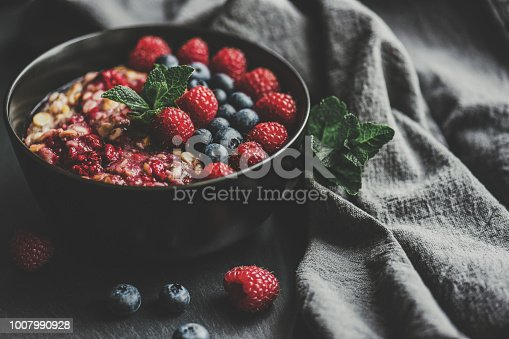 Healthy Eating – gluten free, organic overnight oats with quinoa, goji berries, blue berries and cherries