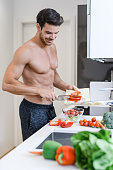 Handsome man at kitchen. Healthy eating concept.