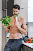 Handsome man with salad. Healthy eating concept.