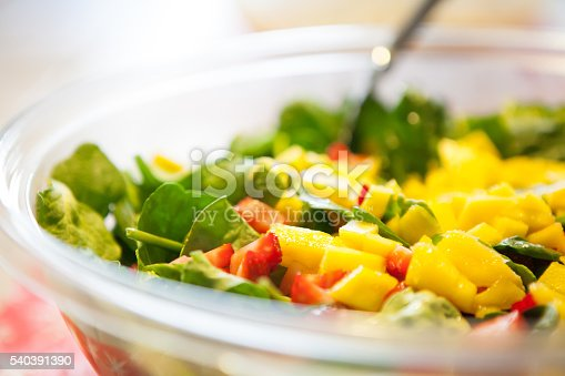 Spinach salad with mango and strawberries.