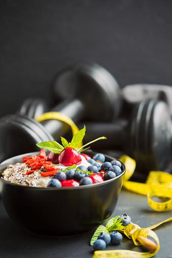 Healthy Eating – gluten free, organic porridge with quinoa, goji berries, blue berries and cherries