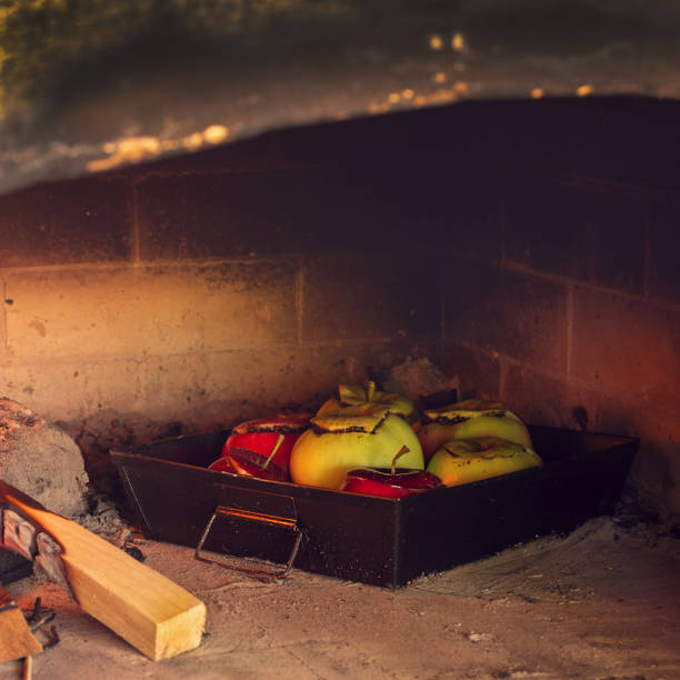 Healthy eating. Rural motives. Apples with stuffing are cooked in a hot oven stock photo