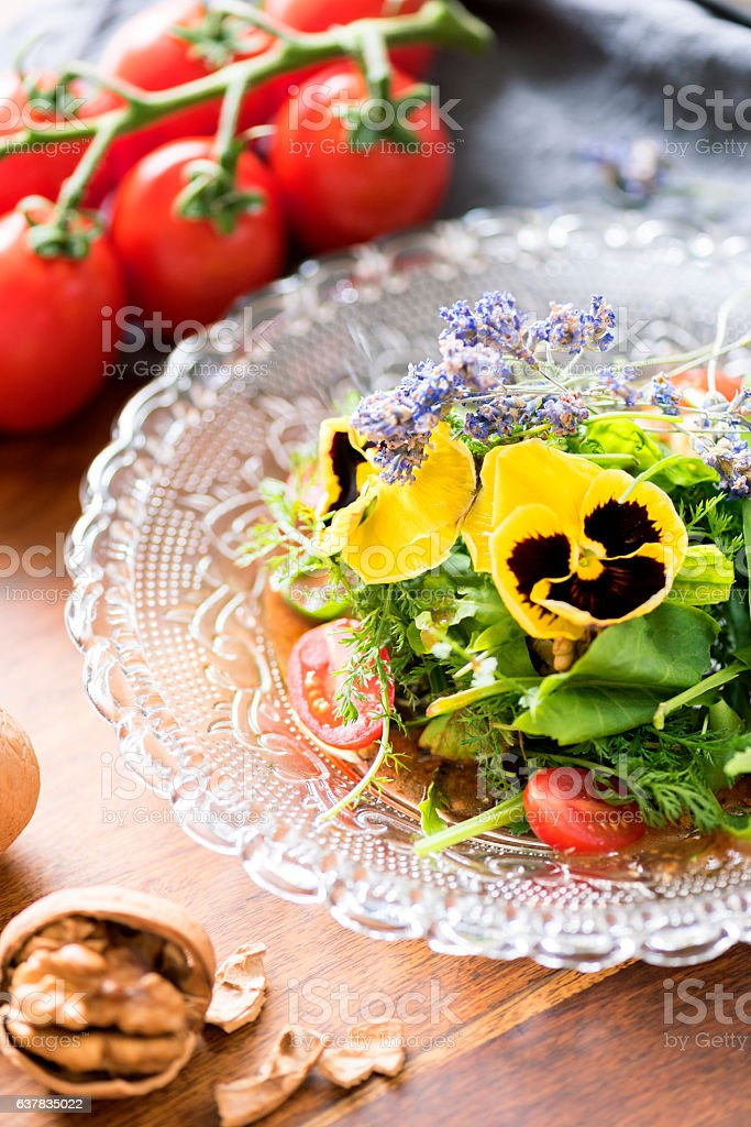 Healthy Eating - Salad with Wild Herbs and Edible Flowers stock photo