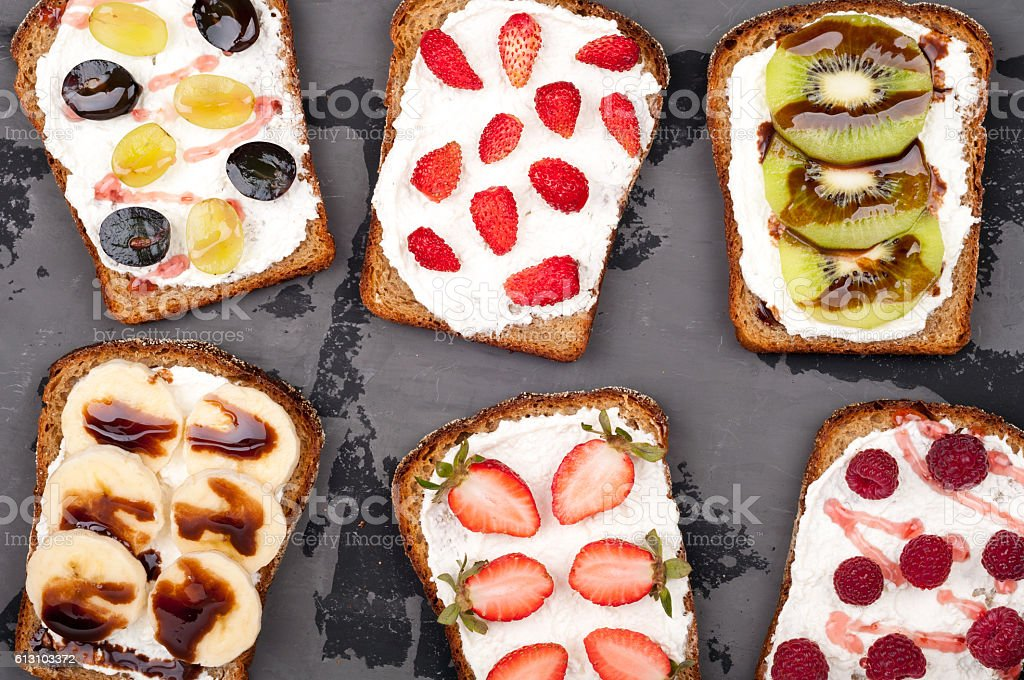 Healthy eating. Sandwiches with cream cheese and berries and fruit stock photo