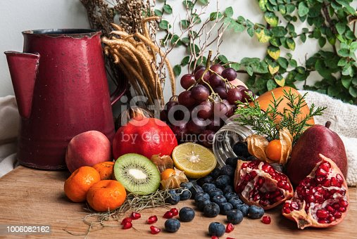 istock Healthy eating theme with different kind of healthy fruits on wooden background. Copy space 1006082162