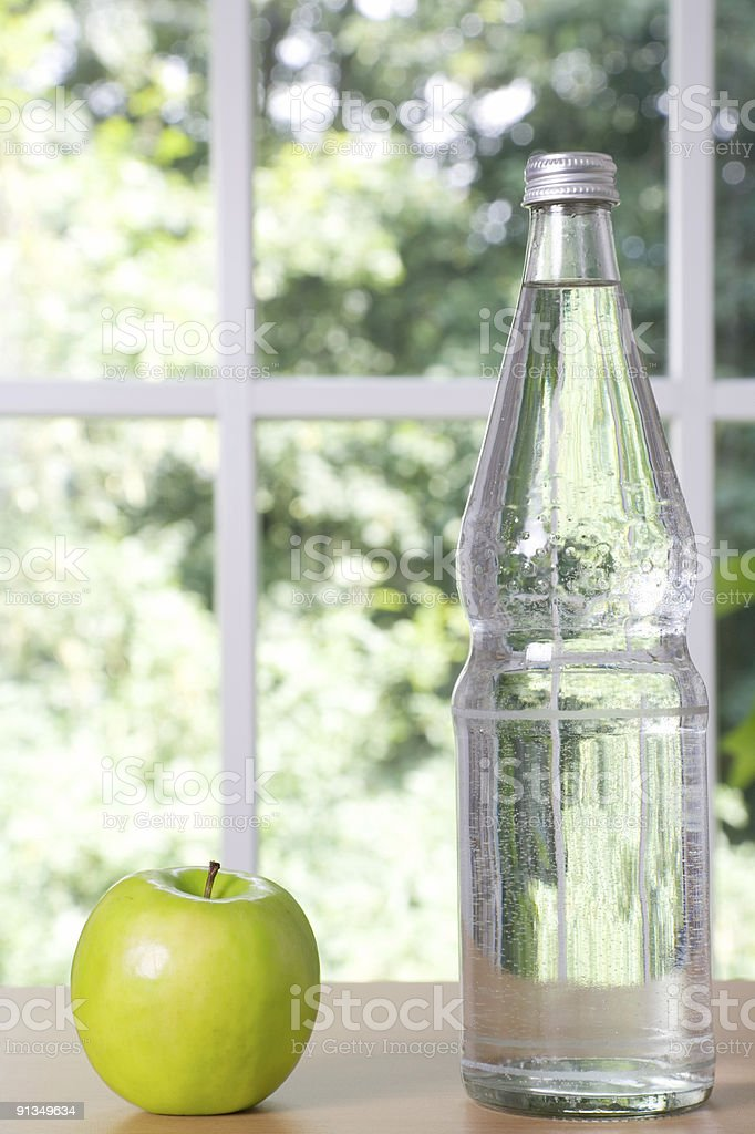 Healthy Eating - Water Bottle and Apple royalty-free stock photo