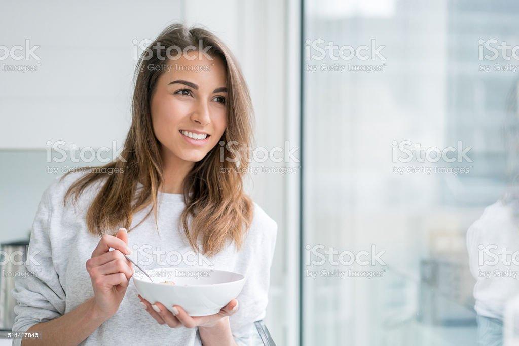 Healthy eating woman having strawberries stock photo