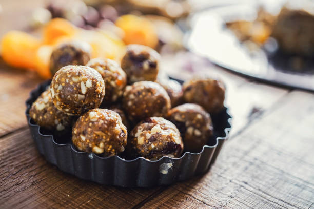 Healthy energy balls made of dried fruits and nuts stock photo