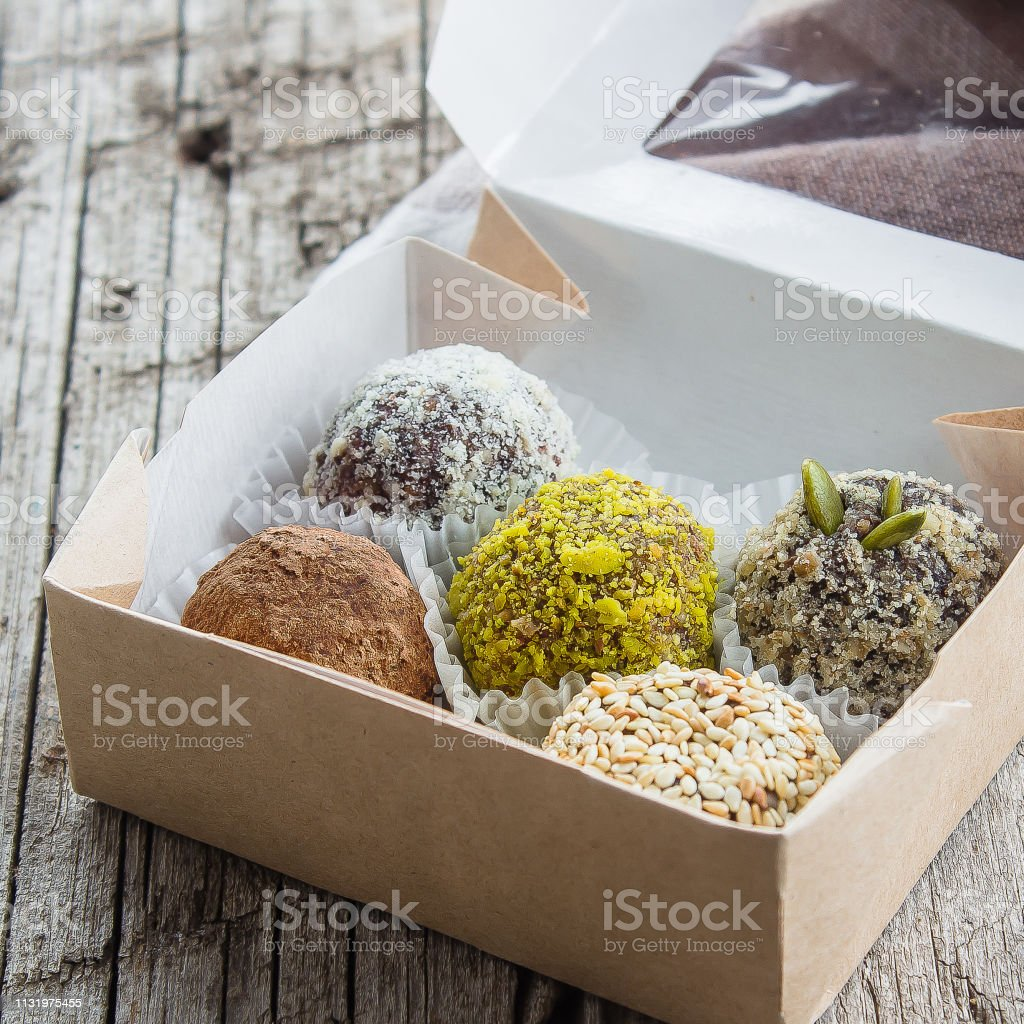 Healthy energy balls made of dried fruits and nuts with coconut...