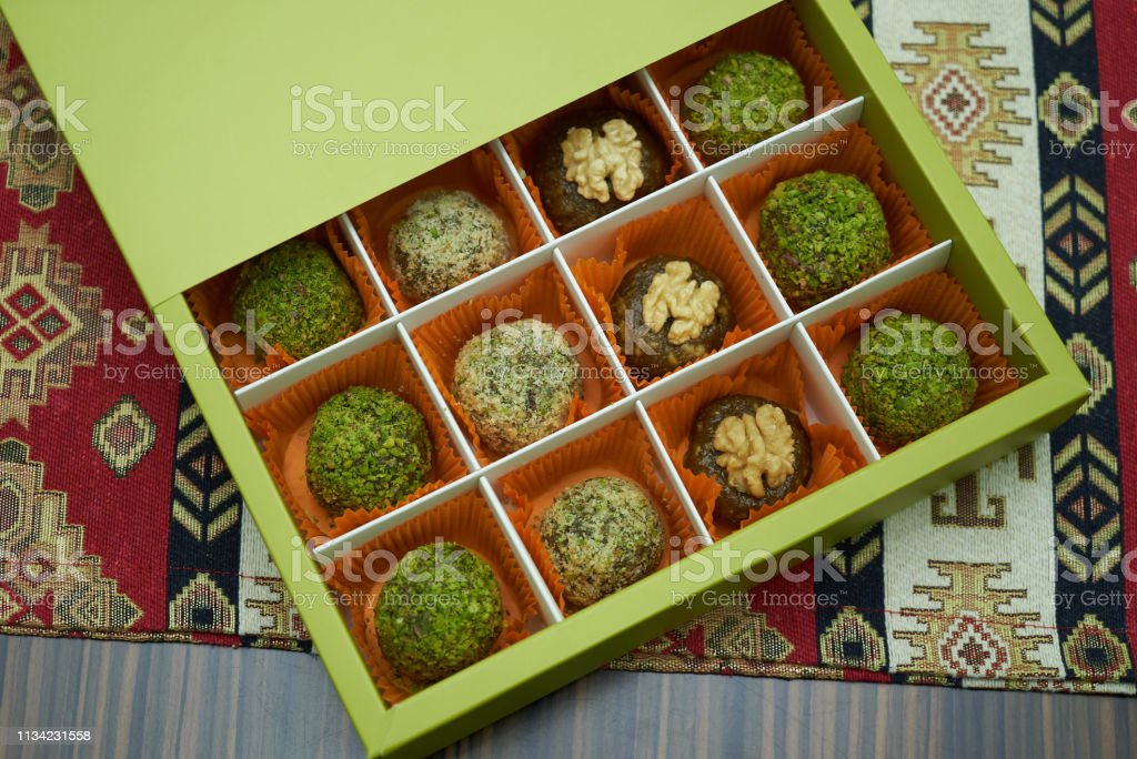 Pistachios candy box, close-up. Healthy energy candy balls with dried...