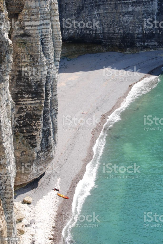 Healthy expansive landscape of a Beach at the foot of a cliff with not recognizable people stock photo