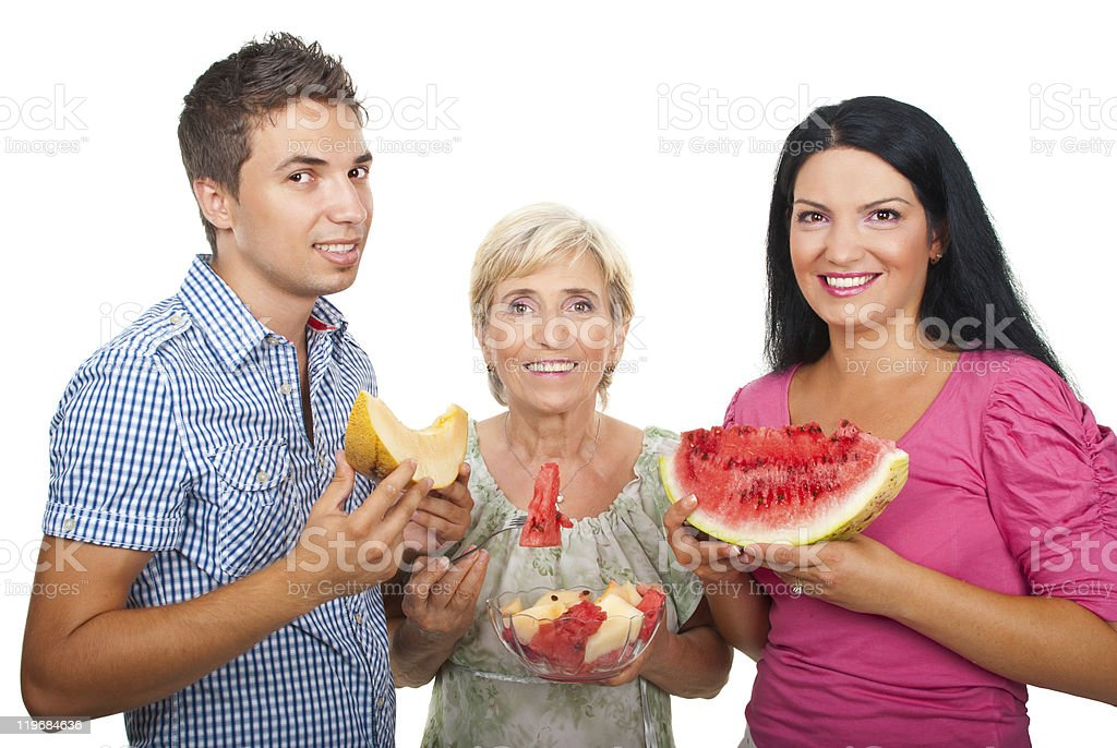Healthy family with  melons royalty-free stock photo