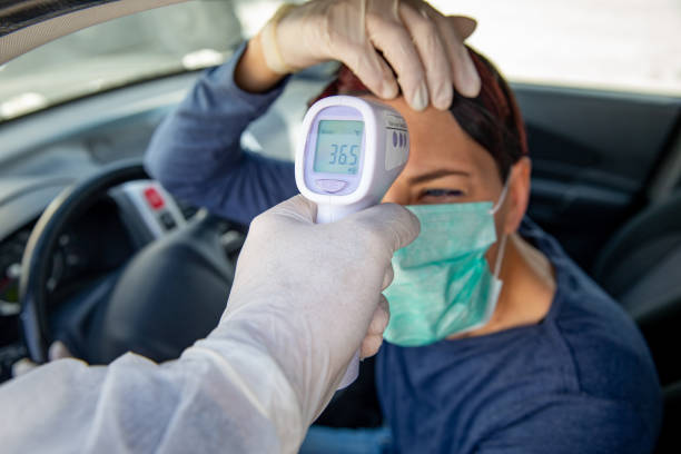 healthy female driver after being testing her body temperature during coronavirus pandemic - essential workers stock pictures, royalty-free photos & images
