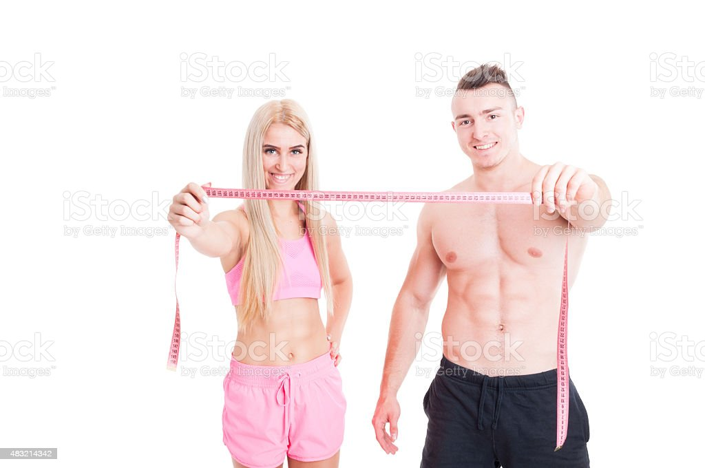 Healthy fitness couple holding meter or centimeter stock photo
