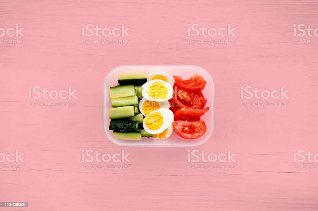 Healthy fitness food in container. Sport food minimalism shot