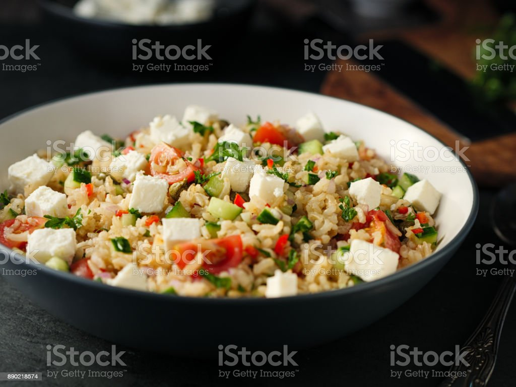 Healthy fluffy brown rice and chopped herbs salad stock photo
