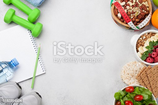 Healthy food concept. Salad, fruits, vegetables, nuts and cereal. Top view flat lay with copy space for your text