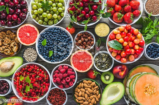 904734850istockphoto Healthy food and fruit selection, nuts, seeds, clean eating and superfoods assortment on table 1067777370
