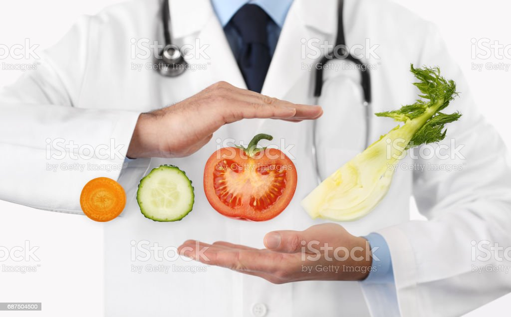 Healthy food and natural nutrition medical diet concept, hands doctor with vegetables stock photo