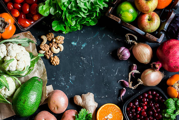 Healthy food background. Assortment of fresh vegetables and fruits - foto stock