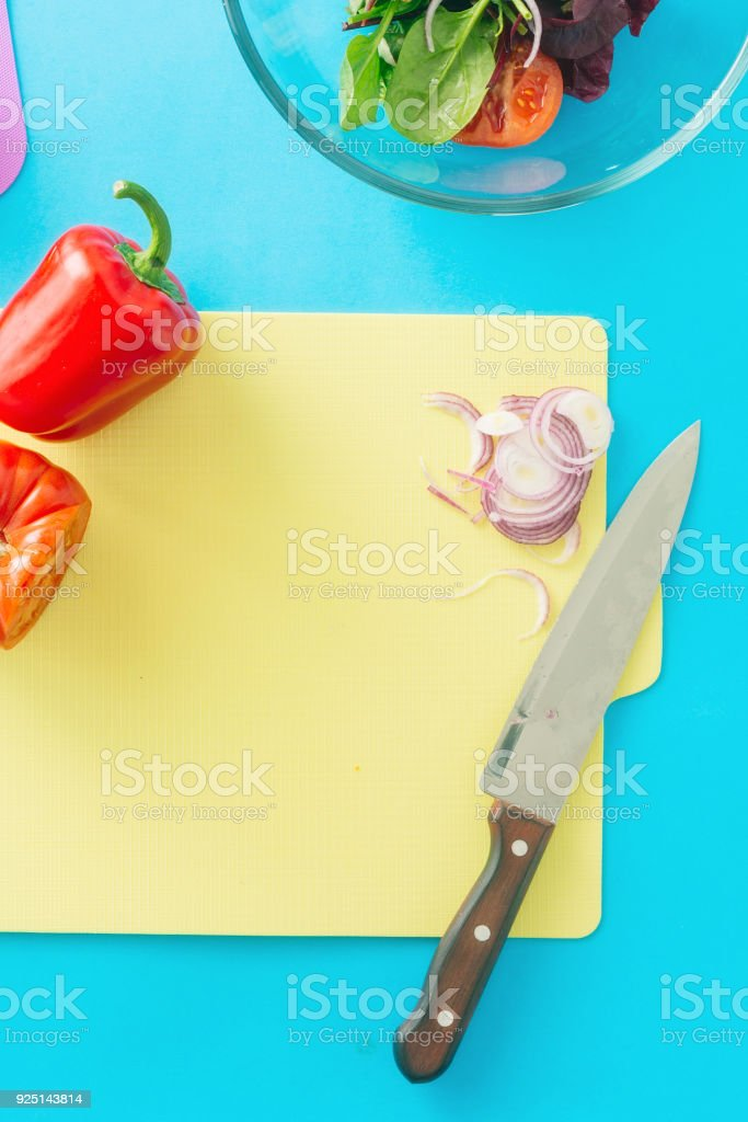 Healthy food background. Fresh biodynamic ingredients for cooking summer salad on blue background, top view - foto stock