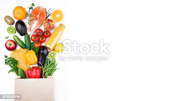 istock Healthy food background. Healthy food in paper bag fish, vegetables and fruits on white. Shopping food supermarket concept. Long format 876656396