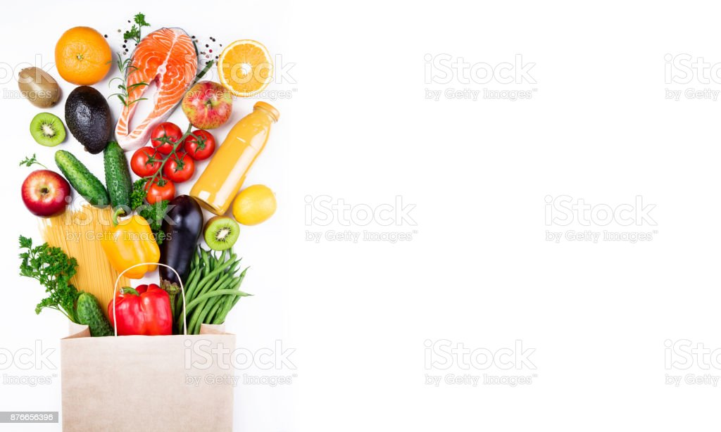 Healthy food background. Healthy food in paper bag fish, vegetables and fruits on white. Shopping food supermarket concept. Long format stock photo