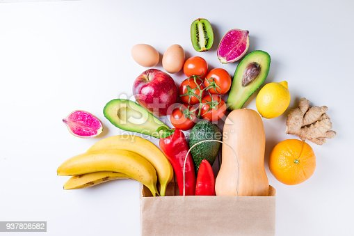 istock Healthy food background. Healthy food in paper bag fruits and vegetables on white. Vegetarian food. Shopping food supermarket concept 937808582