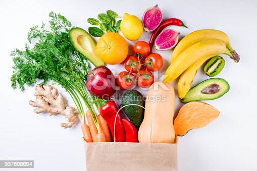 istock Healthy food background. Healthy food in paper bag fruits and vegetables on white. Vegetarian food. Shopping food supermarket concept 937808604