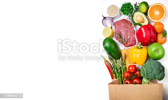 1126188273 istock photo Healthy food background. Healthy food in paper bag meat beef, fruits, vegetables and pasta on white background. Shopping food supermarket concept 1130640213