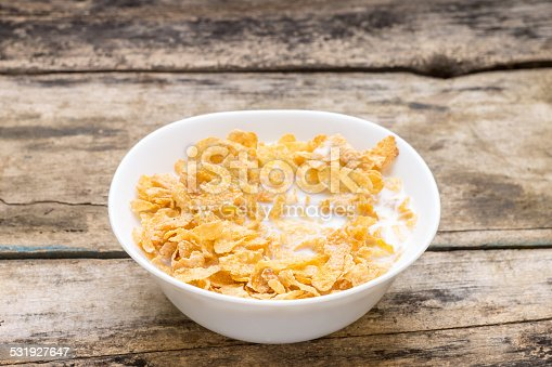 Healthy food background. Corn flakes with milk in white bowl